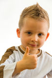 It's ok!. Child showing well done sign using his finger royalty free stock photography