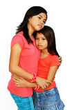 It's okay sis!. A teenager girl trying to comfort her younger sister with a hug & sad eyes stock photos