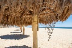 Słomiani handmade parasole na morzu Zdjęcie Royalty Free