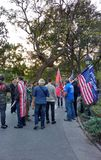 American Flags and Trump Supporters, Washington Square Park, NYC, NY, USA. It`s almost one year after the historic election of Donald Trump as the 45th President Stock Photos