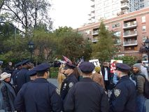 Police Officers Near Protesters, Washington Square Park, NYC, NY, USA. It`s almost one year after the historic election of Donald Trump as the 45th President of Royalty Free Stock Photo