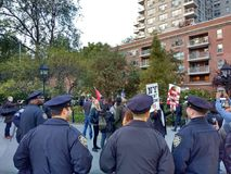 NYPD Police in Washington Square Park, NYC, NY, USA. It`s almost one year after the historic election of Donald Trump as the 45th President of the United States Royalty Free Stock Photo