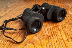 1980s binoculars. 1980s original binoculars. kitchen wood table inside a private apartment. Italy Europe stock images