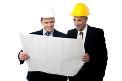 It's our dream project. Two male architect discussing about project plan stock photography