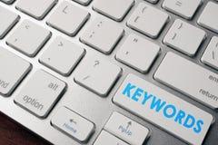 Słowa kluczowe na klawiaturowym guziku Zdjęcie Stock