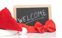 Słowa powitanie i Santa kapelusz Fotografia Stock
