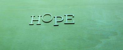 Słowo nadzieja na zielonym tle Obraz Stock