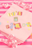 It's a party. Cut out letters spelling it's a party on pink napkins with curled ribbons and confetti, great for invitation cards Stock Images