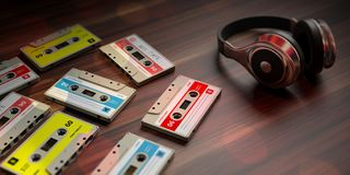 Vintage audio cassettes and dj headphones, wooden background. 3d illustration. 1970s-1980s party music. Vintage audio cassettes and dj headphones, wooden vector illustration