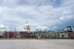 S.Paul Cathedral and Millenium Bridge in London. Image was taken on August 2014 in London, UK Royalty Free Stock Image