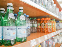 S.Pellegrino. Bottles with San Pellegrino water in a supermarket - focus is on the left, copy space to the right Royalty Free Stock Photos