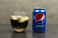That`s Pepsi with ice cubes. Niedomice, Poland - December 22, 2017: An ideal non-alcoholic beverage for a hot summer or party. That`s Pepsi with ice cubes Royalty Free Stock Photos