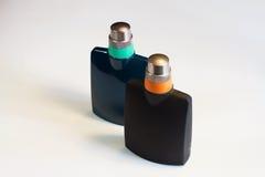 ` S, perfume de los hombres del ` s de las mujeres aislado en el fondo blanco Imágenes de archivo libres de regalías