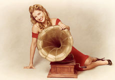 60s pin up girl with vintage record phonograph Stock Images