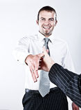 It's A Plesure...!. Young Respectful Corporate Man Shaking Hands For A Good Deal Royalty Free Stock Images