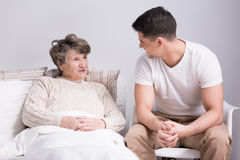 He's the primary caregiver for his grandmother Royalty Free Stock Photography