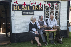 1940s Public House. KENT, UK - AUGUST 28TH 2017: A model set of a traditional 1940s war-time public house with actors in costume sitting outside, at the Military Royalty Free Stock Image