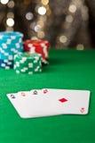 Ás quatro em uma tabela do póquer Fotos de Stock