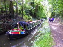 Narrowboat and hikers on towpath Stock Photo