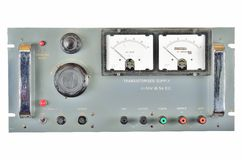 1970's rack mount power supply unit. 1970's large rack mount power supply unit such as would be used as part of a test or service setup in a lab or factory. Grey royalty free stock image