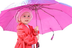 It's raining. Cute little baby with the big pink umbrella Stock Photos
