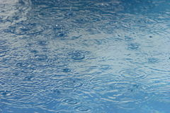 It's raining. Rain falling on water Royalty Free Stock Images