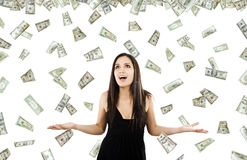 Its raining money. Stock image of woman standing with open arms amidst falling money Royalty Free Stock Photos