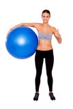 She's ready for a full body workout!. Portrait of an attractive and sporty young woman holding a pilates ball and thumb up to camera while stranding isolated Stock Image