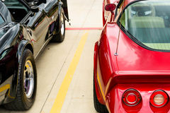 1970s red and black corvettes. Side by side Royalty Free Stock Photo
