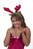 She's a reindeer. Christmas brunette reindeer and gift stocking Royalty Free Stock Photos