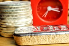 It`s the right time to buy precious metals, gold and silver especially. Closeup of silver coins american one ounce eagles and brick laying on wooden background stock photo