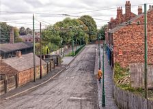 1930s Road in Dudley, West Midlands. Early morning on the Old Birmingham Road at the Black Country Living Museum in Dudley, West Midlands, as the manager of the Stock Photos