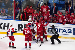 S. Romanov 64 and V. Gavrikov 4 fight. PODOLSK, RUSSIA - NOVEMBER 20, 2016: S. Romanov 64 and V. Gavrikov 4 fight on hockey game Vityaz vs Lokomotiv on Russia stock photos