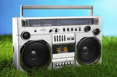 1980s Silver boom box blaster over fresh green grass Royalty Free Stock Photography
