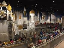 It`s a Small World, Magic Kingdom, Orlando Florida. Tourist wait to begin their journey into `It`s a Small World` ride in Disney World, Orlando Florida Royalty Free Stock Photo