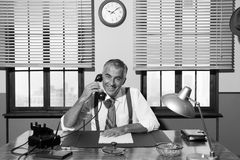 1950s smiling businessman on the phone Stock Image