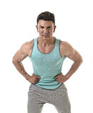 40s sport man and bodybuilder in strong cool attitude corporate pose wearing singlet Stock Image