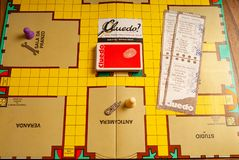 1980s spy game. Named Cluedo with guilty accessories including weapons .kitchen wood table inside a private apartment. Italy Europe stock photography