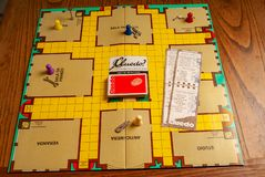 1980s spy game. Named Cluedo with guilty accessories including weapons .kitchen wood table inside a private apartment. Italy Europe royalty free stock images