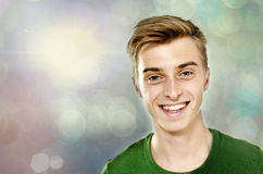 Hes a star. Portrait of a beautiful young man over bokeh background Stock Photos