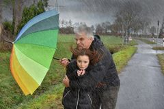 Father and daughter in stormy weather