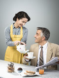 1950s style couple having breakfast Stock Image