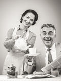 1950s style couple having breakfast Royalty Free Stock Photo