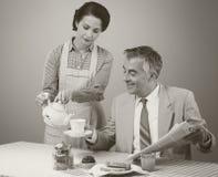 1950s style couple having breakfast Stock Photo