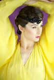 20s style fashion model with yellow dress Stock Photography