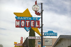 A 1950s style neon sign in the daytime reads �Santa Fe Motel with color TV� in Tehachapi, California Royalty Free Stock Image