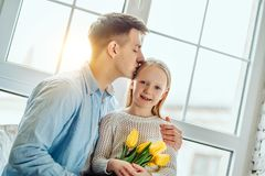 He`s such a proud father. Young father with his adorable daughter stock image