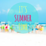 IT'S SUMMER TIME text on blur beach background Stock Image