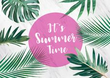 It`s summer time text with tropical leaves on marble background. Royalty Free Stock Image