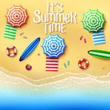 It`s summer time. Top view of stuff on the beach - umbrellas, towels, surfboards, ball, lifebuoy, slipper and starfish on a sunny